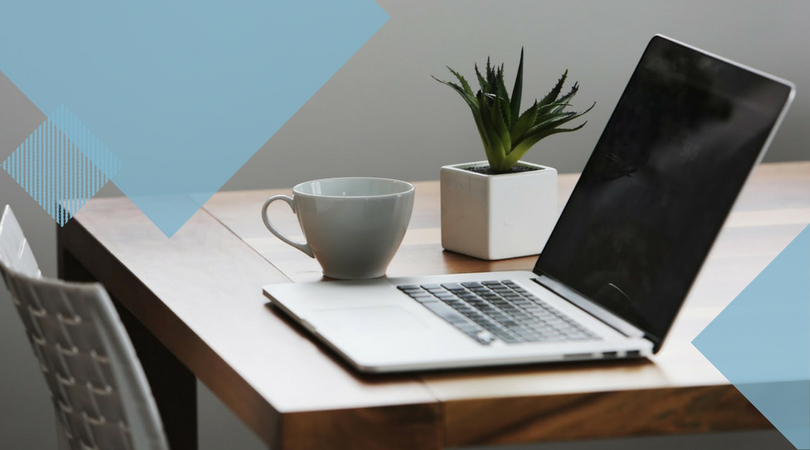 laptop sitting on a wooden table next to a plant and coffee mug with light blue geometric shape overlays