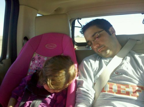 pedro and his daughter asleep in the car