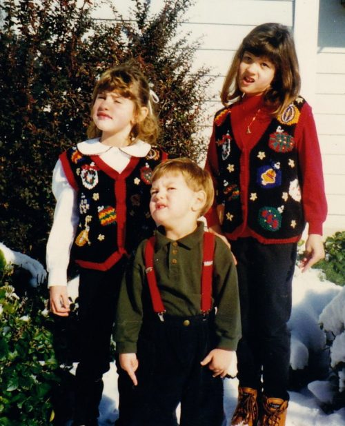 young Nicole and siblings with christmas sweater on
