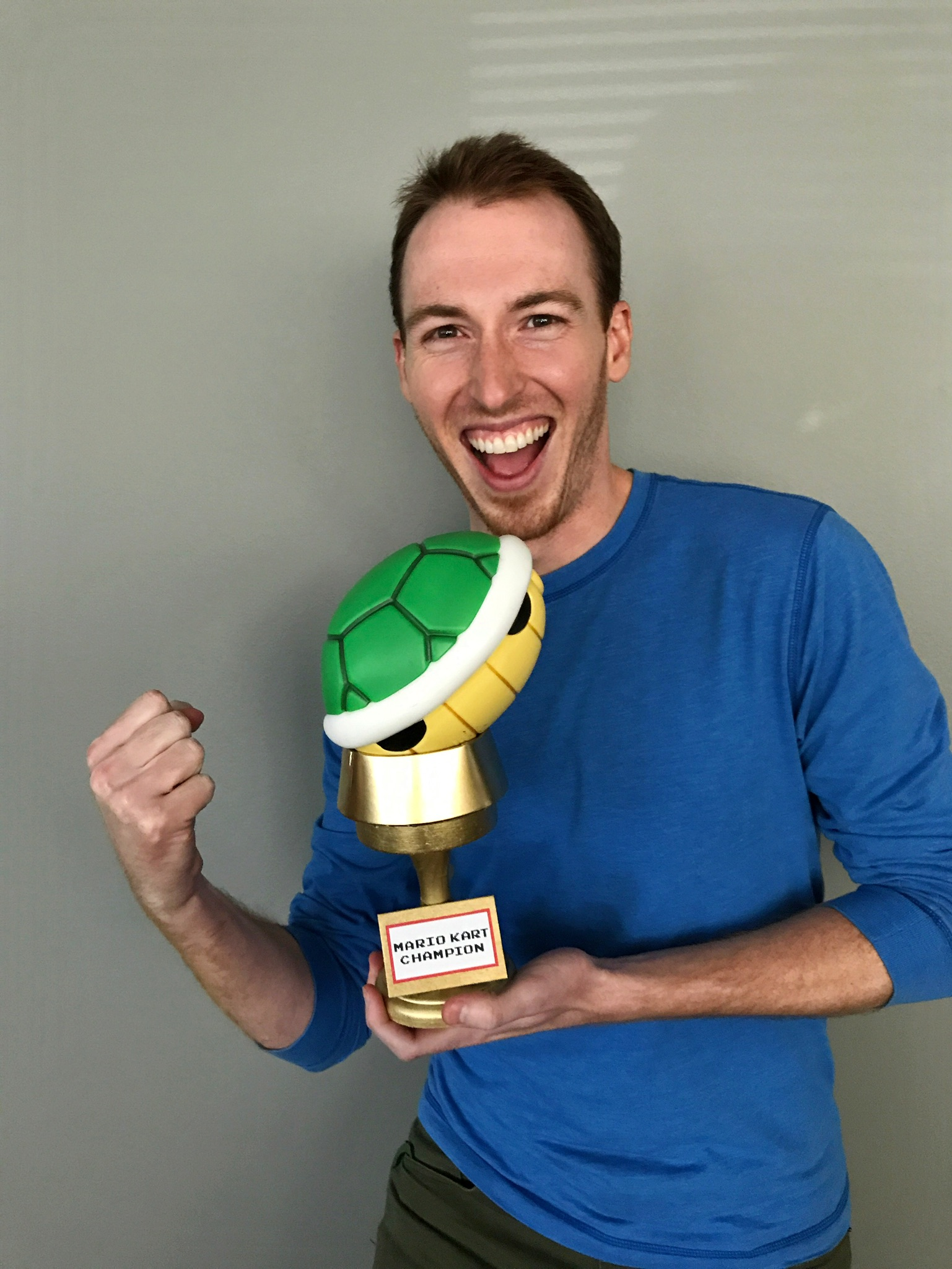 Michael P with Mario Kart Tournament trophy