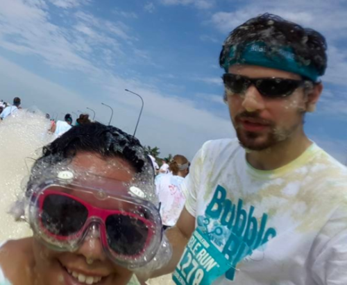 Thomas with wife at Bubble run