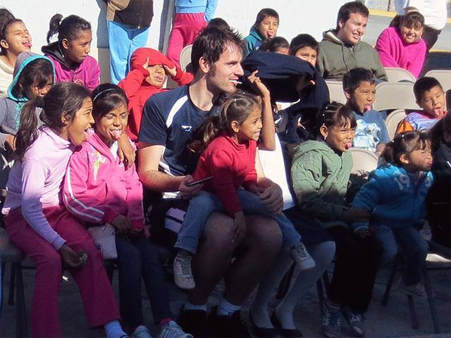 Thomas in Mexico with a group of children