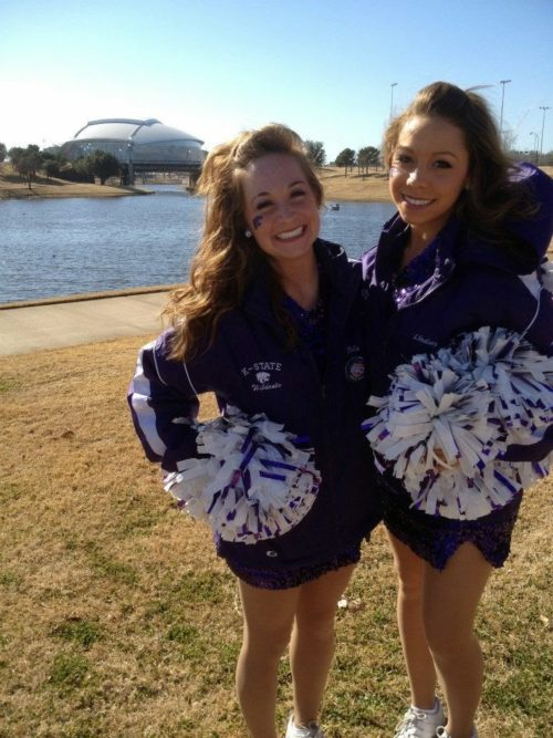 Julie and friend in cheerleader outfits