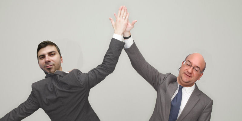 two men high fiving