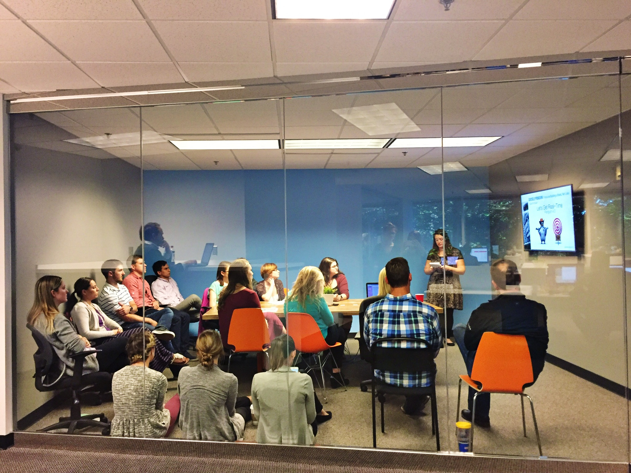 employees of Go Local gather in glass conference room