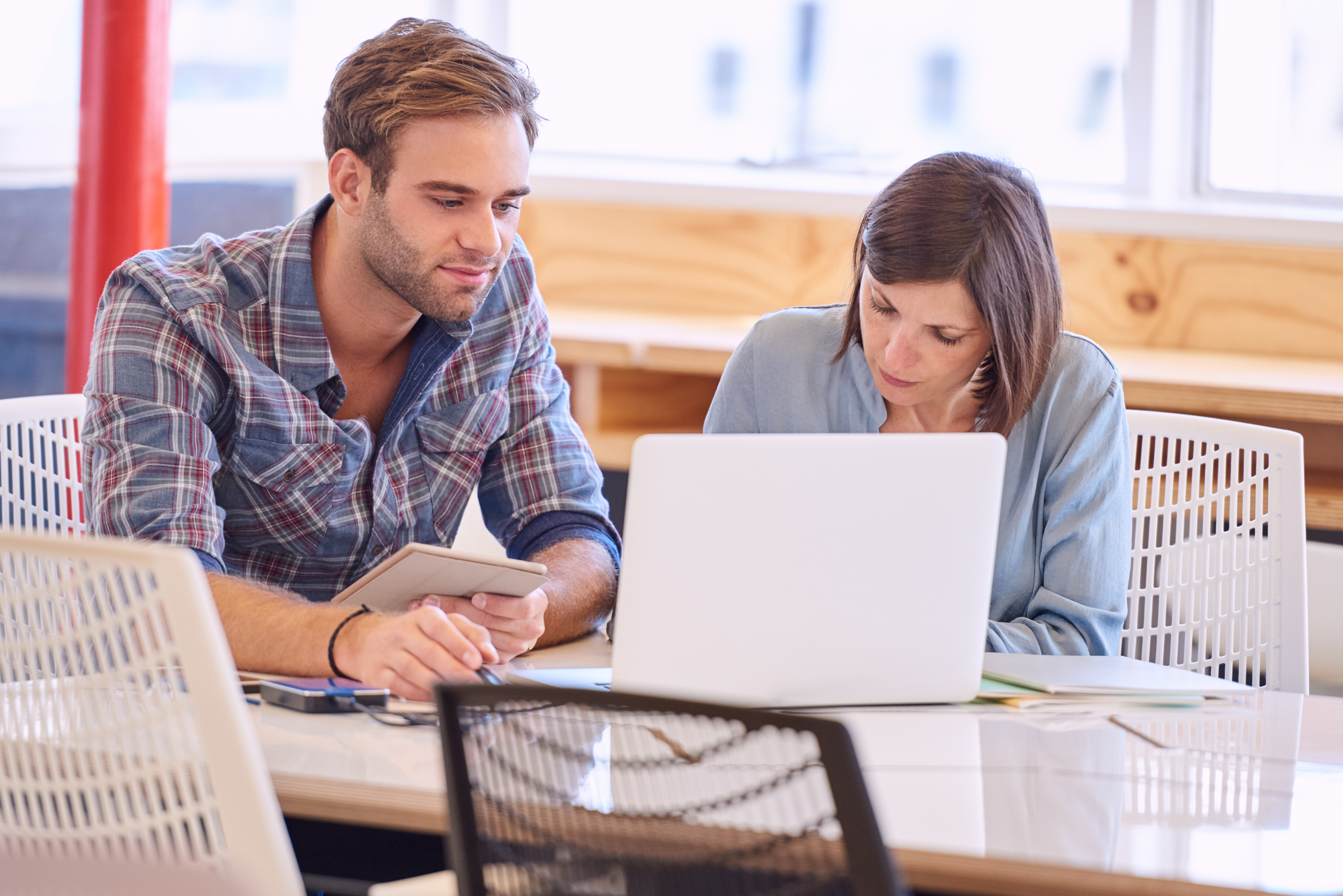 man and woman working on a laptop